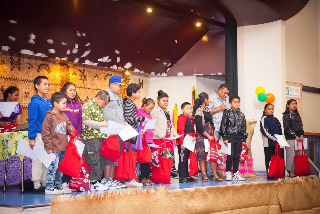 Students receive certificates and goodie bags at the New Zealand Pasifika poem competition.