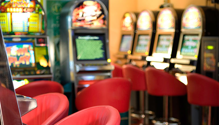 Blurred image of the inside of a pokie's venue
