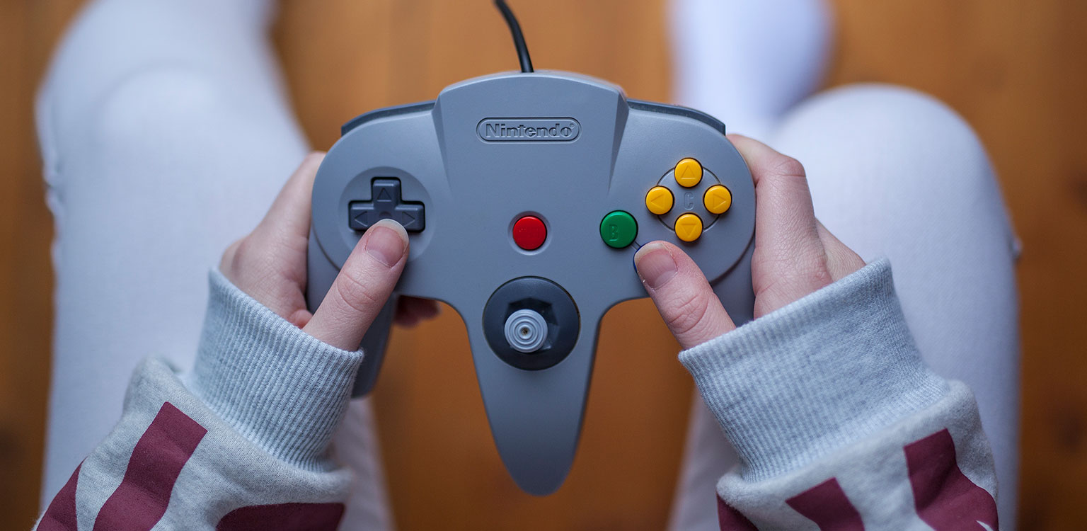 Close up hands holding Nintendo gaming control