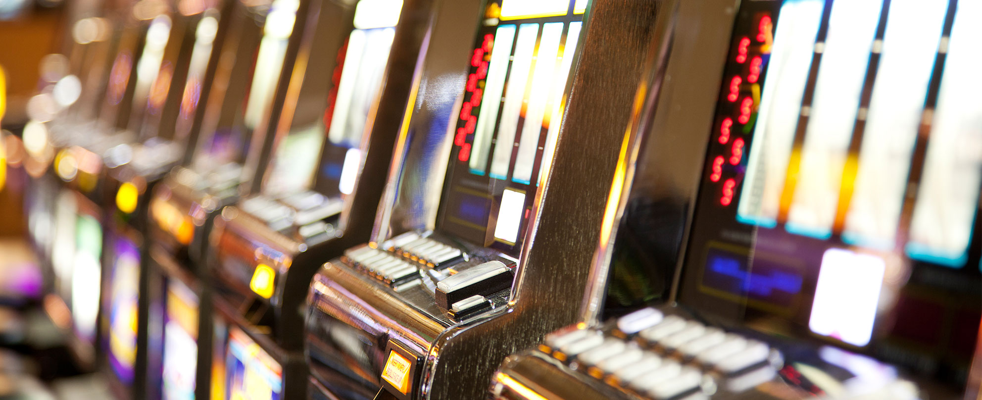 Blurred photo of a row of poker machines
