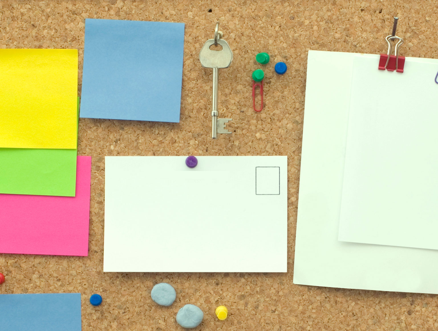 Brightly coloured post-it notes on a corkboard
