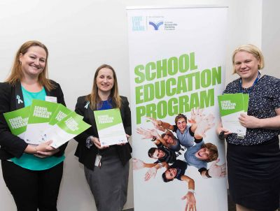 Carol Every from Valad Solutions and Sally Gissing and Alice Dunt from the foundation displaying the School Education Program resources.