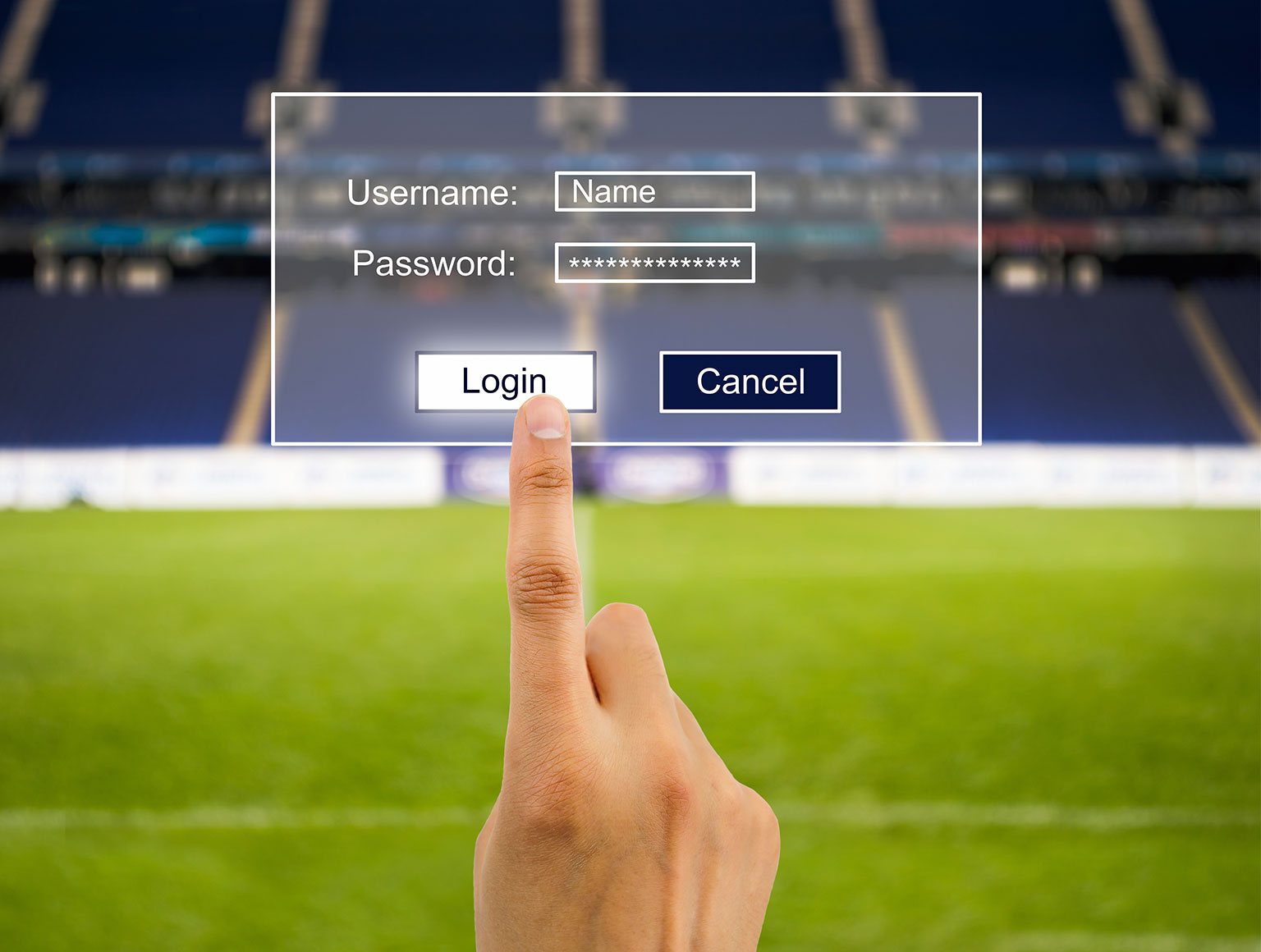 Finger poised to log in to virtual account in front of blurred sports stadium