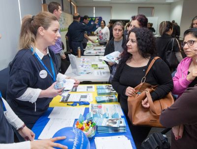 Arabic Welfare staff chat to community members at their information table at Meadow Heights Education Centre, photo: Paul Jeffers